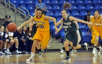 Quinnipiac 77, Wagner 60Kari Goodchild steals the ball in the first half of Quinnipiac's game vs. Wagner Saturday.