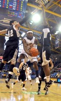 James Johnson passes the ball under the hoop in Saturday's game between Quinnipiac and LIU Brooklyn.