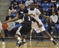 Ousmane Drame guards Jamal Olasewere in the first half of Saturday's game between Quinnipiac and LIU Brooklyn.