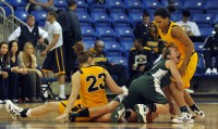 Quinnipiac 77, Wagner 60Players on both teams go after a loose ball in the first half of Saturday's game.