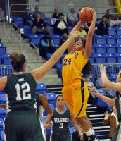 Quinnipiac 77, Wagner 60Quinnipiac's Jasmine Martin goes for a rebound in the first half of Saturday's game vs. Wagner.
