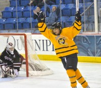 Kelly Babstock reacts after she scores a goal in the second period in Saturday's game between Quinnipiac and Harvard.