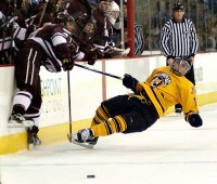 Quinnipiac 7, Colgate 1 A Quinnipiac player falls to the ice after he is hit in Saturday's game vs. Colgate.