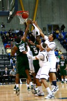 Wagner 51, Quinnipiac 50Players on both Quinnipiac and Wagner reach for a rebound in Saturday's game.
