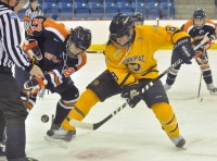 Syracuse 3, Quinnipiac 2Quinnipiac's Kelly Babstock faces off in the first period of Saturday's game vs. Syracuse.
