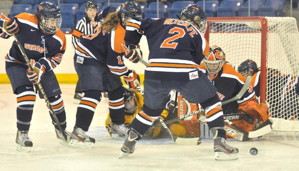 Syracuse 3, Quinnipiac 2Quinnipiac's Brittany Lyons is surrounded by several Orange players in the second period of Saturday's game.