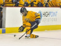 Syracuse 3, Quinnipiac 2Quinnipiac's Amanda Colin kneels for the puck in the second period of Saturday's game.