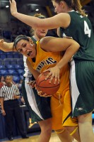 Quinnipiac 77, Wagner 60Quinnipiac's Brittany McQuain is smothered by two Wagner players in the post in the second half of Saturday's game.