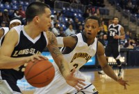 Dave Johnson guards Jason Brockman late in the second half of Saturday's game between Quinnipiac and LIU Brooklyn.