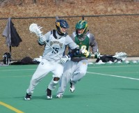 Quinnipiac vs. Vermont men's lacrosse scrimmageQuinnipiac's Basil Kostaras aggressively breaks into the attacking zone.