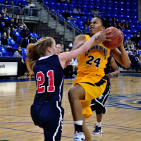 Quinnipiac 64, St. Francis (N.Y.) 41  Jasmine Martin gets fouled by Katie Fox as she goes up for a shot.