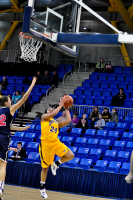 Quinnipiac 64, St. Francis (N.Y.) 41  Jasmine Martin goes up for a layup while being defended by Kim Snauwaert.