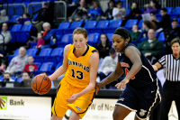 Quinnipiac 64, St. Francis (N.Y.) 41  Camryn Warner dribbles the ball while being defended by Jaymee Veney.