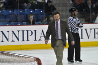 Quinnipiac 4, Brown 1  Brown coach Brendan Whittet walks off the ice after being ejected.