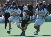 Brown 12, QU 7 Chris Coppolecchia and Greg Pendergast defend the zone against a Brown attack.