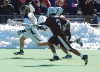 Brown 12, QU 7Pat Mulligan breaking into the offensive zone with defenders at his back.