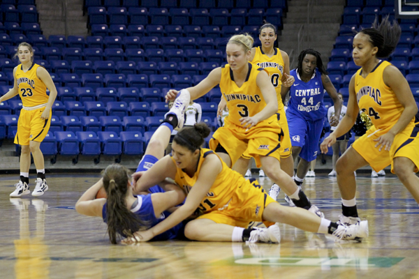 Quinnipiac 58, CCSU 49  Bobcats and Blue Devils battle for a loose ball.