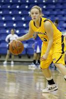 Quinnipiac 58, CCSU 49 Lisa Lebak dribbles the ball against CCSU.