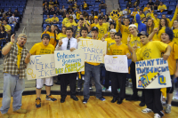 Quinnipiac 73, Robert Morris 69Fans pose with posters before Saturday's game.