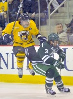 Quinnipiac 2, Dartmouth 1Quinnipiac's Connor Jones jumps over Dartmouth's Connor Coggin in the first period of Saturday's game.
