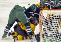 Quinnipiac 2, Dartmouth 1Quinnipiac's Spencer Heichman is hit by two Dartmouth players after the whistle in the second period of Saturday's game.