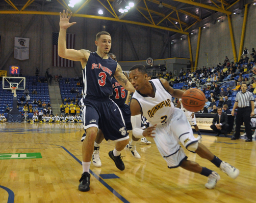 St. Francis (N.Y.) 64, Quinnipiac 56Quinnipiac guard Dave Johnson drives down the baseline past St. Francis (N.Y.)'s Ben Mockford in the second half of Thursday's game.