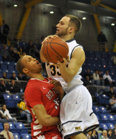 Quinnipiac 77, Saint Francis (Pa.) 44Saint Francis' Anthony Ervin is called for a blocking foul against Quinnipiac's Kevin Tarca in Thursday's game.