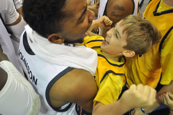 Quinnipiac 77, Saint Francis (Pa.) 44Quinnipiac guard James Johnson celebrates with a fan after the Bobcats beat Saint Francis (Pa.) on Thursday night.