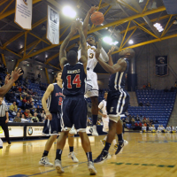 St. Francis (N.Y.) 64, Quinnipiac 56Quinnipiac's James Johnson is fouled going up for a shot in the second half of Thursday's game vs. St. Francis (N.Y.).