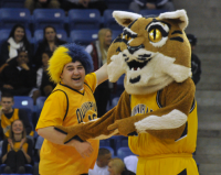 St. Francis (N.Y.) 64, Quinnipiac 56Senior Andrew McDermott celebrates with Boomer the Bobcat after he wins a contest during a media timeout in the second half of Thursday's game.