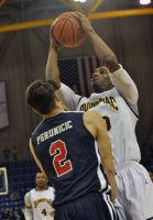 St. Francis (N.Y.) 64, Quinnipiac 56Quinnipiac's Garvey Young goes up for a layup against St. Francis (N.Y.)'s Stefan Perunicic in the second half of Thursday's game.