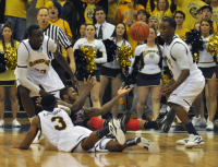 Quinnipiac 73, Robert Morris 69Four players go for a loose ball in the second half of Saturday's game.