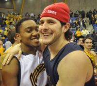 Quinnipiac 73, Robert Morris 69Quinnipiac's James Johnson celebrates with a fan after the Bobcats win on Saturday.