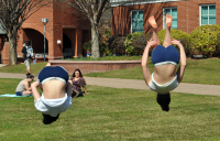 Fun in the sunQuinnipiac students spend time outside on the Quad Thursday afternoon performing backflips.