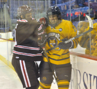 Brown 4, Quinnipiac 1Brown's Kyle Quick checks Quinnipiac's Reese Rolheiser into the boards in the first period of Friday's game.