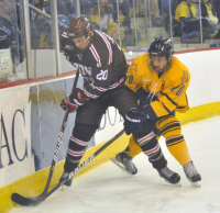 Brown 4, Quinnipiac 1Quinnipiac's Matthew Peca vies for the puck with Brown's Dennis Robertson in the first period of Friday's game.
