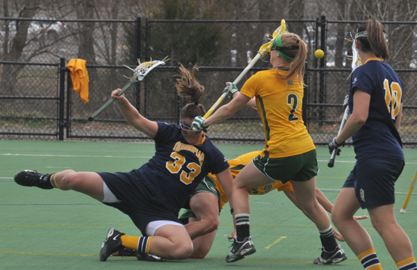Vermont 18, Quinnipiac 9Quinnipiac's Lianne Toomey falls to the ground in the first half of Wednesday's game vs. Vermont.