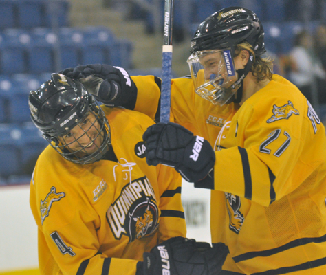 Quinnipiac 3, Brown 0Quinnipiac's Loren Barron celebrates with teammate Zach Tolkinen after a goal in the first period of Saturday's game vs. Brown.