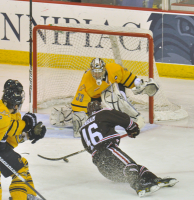 Brown 4, Quinnipiac 1Quinnipiac goaltender Eric Hartzell stops a shot by Brown's Jimmy Siers in the third period of Friday's game.