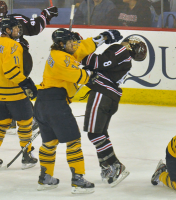Brown 4, Quinnipiac 1Quinnipiac's Mike Dalhuisen hits Brown's Jarred Smith in the third period after Brown scores its third goal of Friday's game.