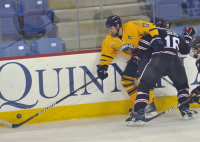 Brown 4, Quinnipiac 1Quinnipiac's Bryce Van Brabant controls the puck as he is being checked into the boards by Brown's Jimmy Siers in the third period of Friday's game.
