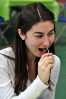 Bone Marrow DriveA Quinnipiac student swabbing her cheek, Thursday at Burt Kahn for Kappa Alpha Theta bone marrow drive.