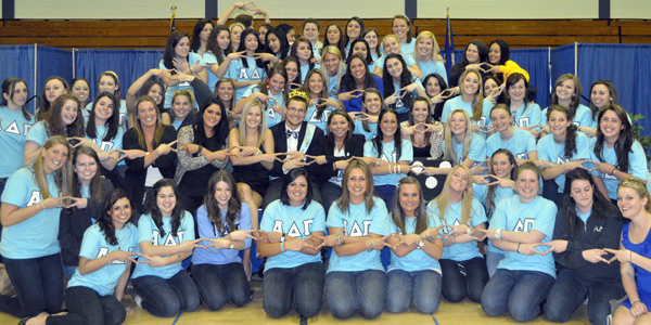 King Of DiamondsSisters of Alpha Delta Pi show their diamonds with the newly crowned King of Diamonds Tom Booth, Monday night in Burt Kahn.