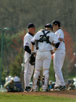The Quinnipiac baseball team beat Mount Saint Mary's in the second game of their doubleheader on Saturday, April 14Quinnipiac's Kyle Nisson and Spencer Kane consult with their coach during their game on Saturday
