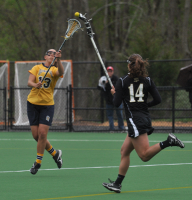 Bryant 8, Quinnipiac 6Quinnipiac's Sarah Allen catches the ball in the first half of Sunday's game vs. Bryant.