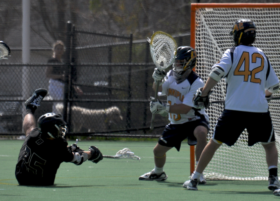 Bryant 9, Quinnipiac 5Quinnipiac's Dylan Torey tries to make a save in the third quarter of Saturday's game vs. Bryant.