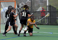 Bryant 8, Quinnipiac 6Quinnipiac's Lianne Toomey falls to the ground in the second half of Sunday's game vs. Bryant.