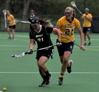 Bryant 8, Quinnipiac 6Quinnipiac's Kyra Ochwat chases down a loose ball in the second half of Sunday's game vs. Bryant.
