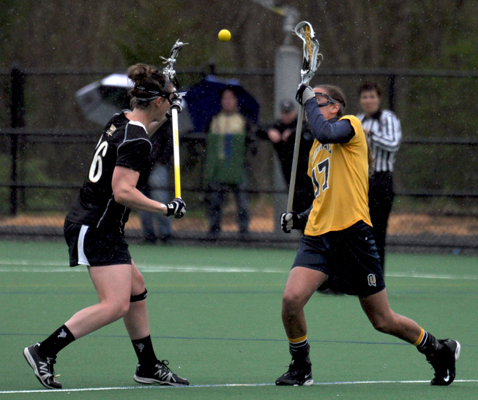 Bryant 8, Quinnipiac 6Quinnipiac's Phoebe Laplante tries to gain possession of the ball from a draw control in the second half of Sunday's game vs. Bryant.