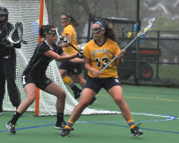 Bryant 8, Quinnipiac 6Quinnipiac's Sarah Allen controls the ball by the crease in the second half of Sunday's game vs. Bryant.
